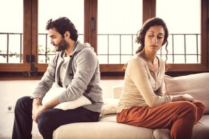 Couple not talking after a fight on the sofa in living room at home